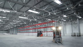 Cargo Machine Moves in Spacious Warehouse stock footage