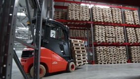 Cargo Machine Moves in Spacious Warehouse stock video footage