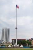 Cargo malaio da bandeira no quadrado de Merdeka Fotos de Stock