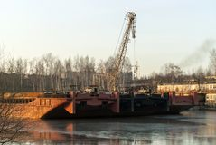 Cargo non-propelled barges hibernate in the backwater royalty free stock image
