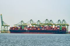 Cargo operations on a container ship in China stock photography