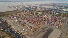 Cargo and passenger seaport in surabaya, java, indonesia. Aerial view container terminal port surabaya. cargo industrial port with containers, crane. Tanjung royalty free stock photos