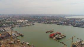 Cargo and passenger seaport in surabaya, java, indonesia. Aerial view cargo and passenger seaport with ships and crane Tanjung Perak, surabaya, indonesia. docks stock image