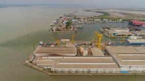 Cargo and passenger seaport in surabaya, java, indonesia. Aerial view cargo and passenger seaport with ships and crane Tanjung Perak, surabaya, indonesia. docks royalty free stock photo