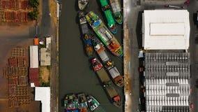 Cargo and passenger seaport in surabaya, java, indonesia. Aerial view cargo and passenger seaport with ships and crane Tanjung Perak, surabaya, indonesia. docks stock photo