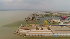 Cargo and passenger seaport in surabaya, java, indonesia. Aerial view cargo and passenger seaport with ships and crane Tanjung Perak, surabaya, indonesia. docks stock images