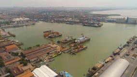 Cargo and passenger seaport in surabaya, java, indonesia. Aerial view cargo and passenger seaport with ships and crane Tanjung Perak, surabaya, indonesia. docks stock photos