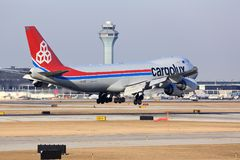 Cargo plane arriving in Chicago. CHICAGO, ILLINOIS, USA - March 19, 2017: Photo of a Cargolux Airlines cargo aircraft Boeing 747-8F arriving in for a landing at Stock Photo