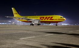 Cargo Plane. BUDAPEST, HUNGARY - MARCH 5: DHL Airbus A300 cargo plane at Budapest Airport, March 5th 2014. DHL is a world market leader in air mail Royalty Free Stock Photos