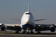 Cargo plane. Eye to eye with white cargo plane Royalty Free Stock Photo