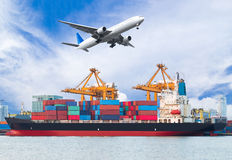 Cargo plane flying above ship port for logistic import export. Background Royalty Free Stock Photo