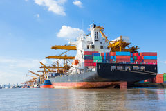 Cargo plane flying above ship port for logistic import export Stock Images