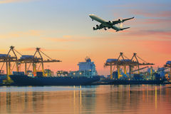 Cargo plane flying above ship port use for transportation and fr
