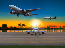 Cargo plane flying over airport against beautiful morning light Royalty Free Stock Photos