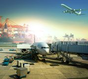Cargo plane loading commercial goods against large logistic ,shipping port background stock photos