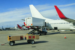 Cargo plane loading commercial product in airport Royalty Free Stock Photo