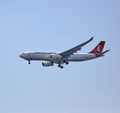 The cargo plane of Turkish Airlines flying in the sky. Royalty Free Stock Photography