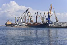 Cargo port. Ships and craness in port Royalty Free Stock Photo