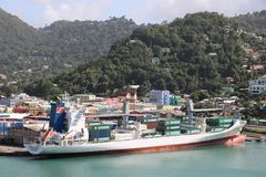 Cargo port in Castries, Saint Lucia. Ships and containers in a cargo port in Castries, the capital of Saint Lucia. In the background typical landscape of this Stock Photos