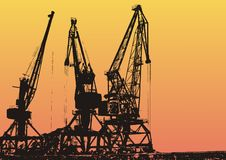 Cargo port with cranes. Cargo port with industrial cranes against sunset sky Royalty Free Stock Photography
