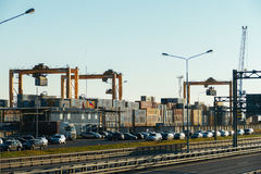 Cargo port with cranes, containers and highway in front of him Royalty Free Stock Image
