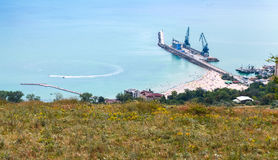 Cargo port with cranes on pier. Balchik town Stock Photos