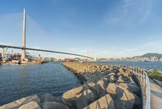 Cargo port, dam and bridge stock photo