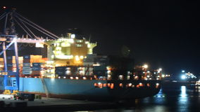 Cargo port at night works stock footage