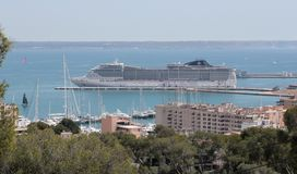 Palma de mallorca port cruises docking area view. The cargo port of Palma de Mallorca view from nearby hill of Bellver. Local government will avoid touristic Stock Photo