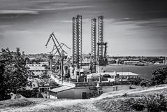 Cargo port in Pula, Istria, Croatia, colorless. Cargo port in Pula, Istria, Croatia. Travel destination. European industrial scene. Black and white photo royalty free stock image