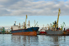 Cargo port Klaipeda Lithuania. Cargo ship in industrial harbour with cranes in Klaipeda, Lithuania Royalty Free Stock Image