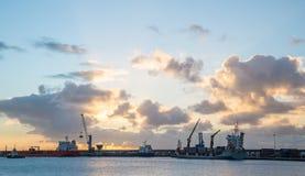 Cargo port ship sunrise sunset clouds Stock Image