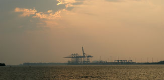 Cargo port on a sunset, Cochin, Kerala, South India Royalty Free Stock Photo