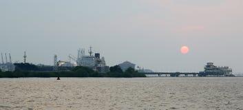 Cargo port on a sunset, Cochin, Kerala, South India Royalty Free Stock Photo