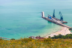 Cargo port terminal with cranes on pier. Balchik Royalty Free Stock Images