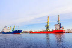 Cargo port. The two ships. Ship red collection. The blue ship is Stock Images