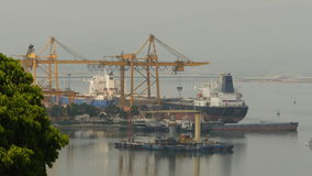 Cargo port in the work. Ha Long Bay. Vietnam. Shot in 4K - 3840x2160, 30fps stock video