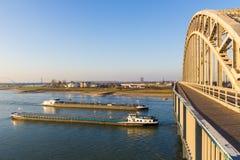 Free Cargo River Barges Passing Under Waal Bridge In Nijmegen Stock Photography - 138279972