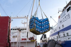 Cargo. Sea of Okhotsk, Russia – October 2th, 2014: Sea of Okhotsk, overload of frozen fish products from the sea trawler KAPITAN KAYZER in hold of a sea Stock Photo