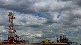 Cargo sea port. Sea cargo cranes. International transportation logistic container Seascape. sky is summer clouds Royalty Free Stock Image