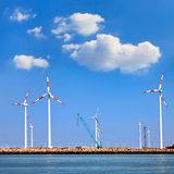 Cargo sea port. Wind turbines. Royalty Free Stock Image