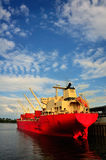 Cargo ship. A bright colored ship docks at the harbour Royalty Free Stock Photo