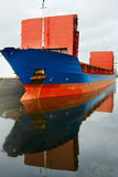 Cargo ship. Big Cargo Ship in the docks and reflection Stock Photo