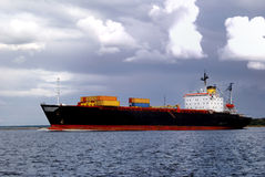 Cargo ship. Is leaving port sailing away stock photography