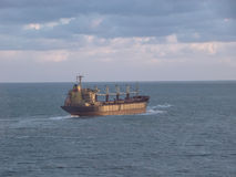 Cargo ship. Over the sea stock images