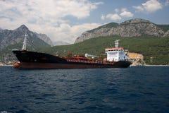 Cargo ship. Giant cargo ship in front of Toros Mountain, Antalya Stock Image