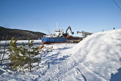Cargo ship. Cargo ship to dock at Bakke in Halden municipality. Bakke is a small village just outside Halden and here lies a large gravel and sand pits. Here is Stock Image