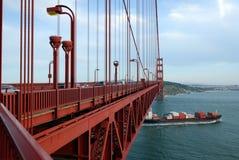Cargo Ship. Under the Bridge Stock Images