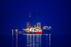 Cargo ship. A heavy lift vessel loaded a jack up rig Stock Photos