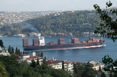 Cargo Ship. A huge cargo ship carrying shipping containers in the Bosphorus Strait Stock Photos